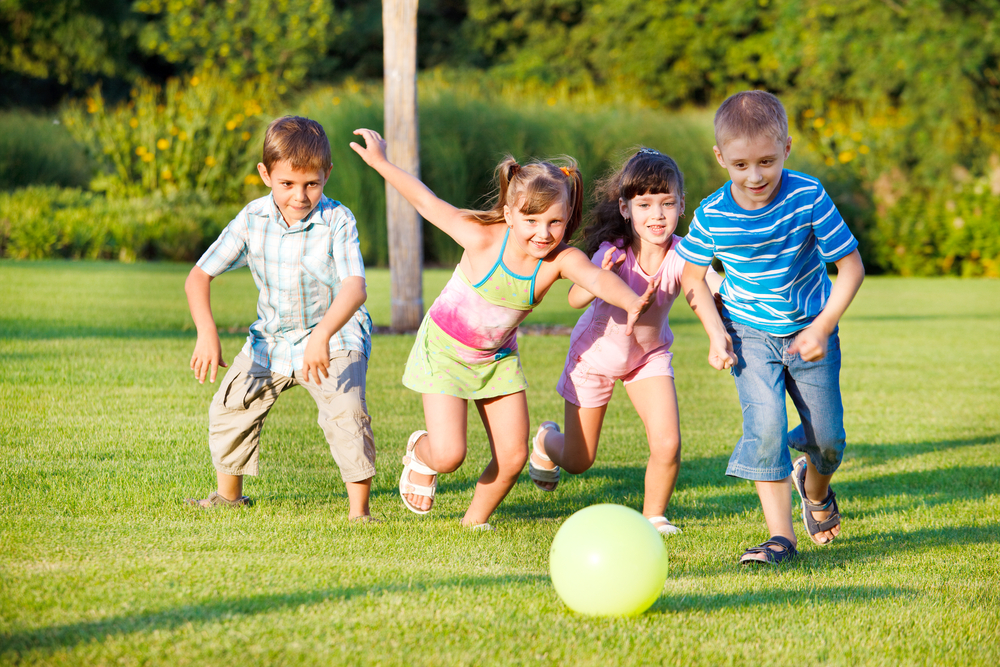 children enjoying a lawn by akron canton lawn care due to their fertilization and weed control treatments, richfield oh, copley oh, bath twp oh, fairlawn oh, lawn service