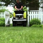 Applying fertilizer and spraying weed control, lawn care services provided by Akron Canton Lawn Care, grub control, pest control, copley ohio, north canton ohio, hudson oh